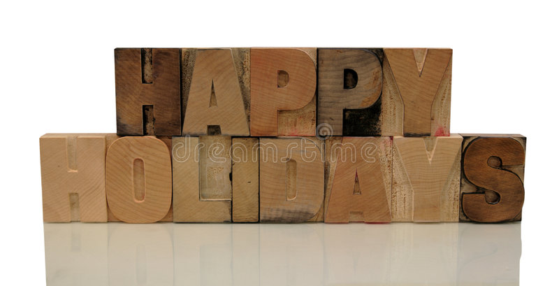 Happy holidays in letterpress wood type royalty free stock images