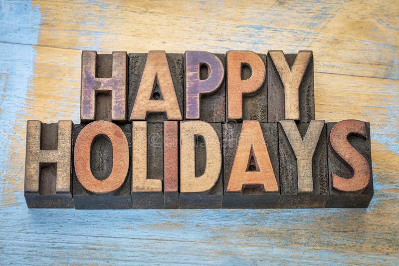 Happy Holidays in letterpress wood type stock photo