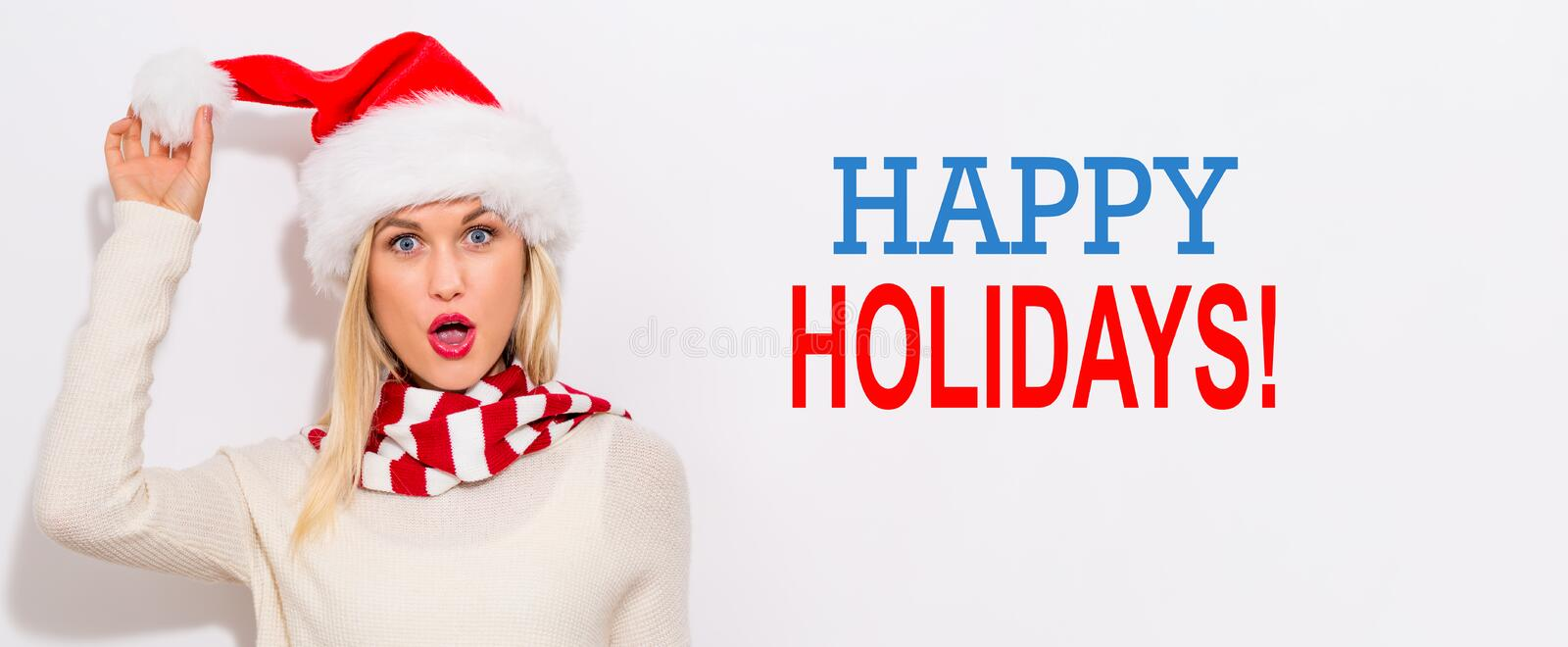 Happy holidays message with woman with Santa hat royalty free stock photo