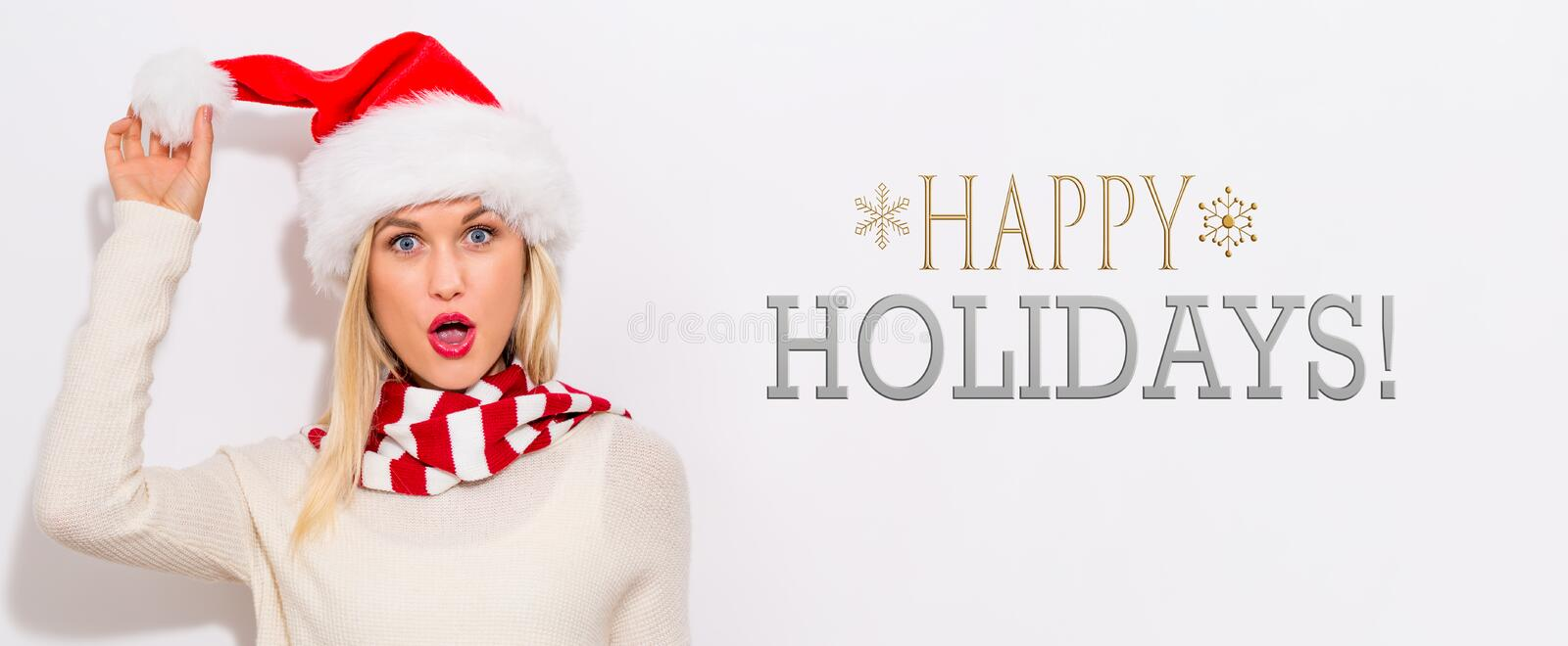 Happy holidays message with woman with Santa hat stock images