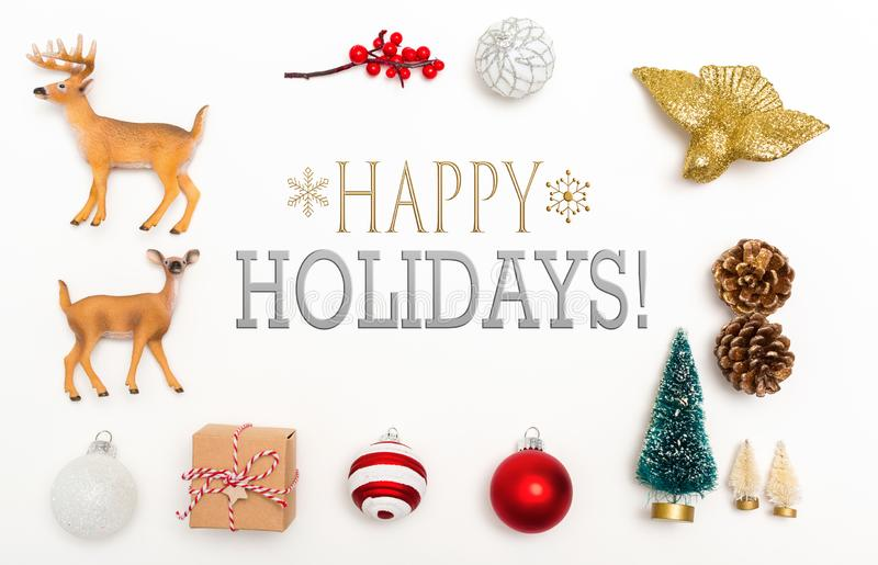Happy holidays message with Christmas ornaments stock photography
