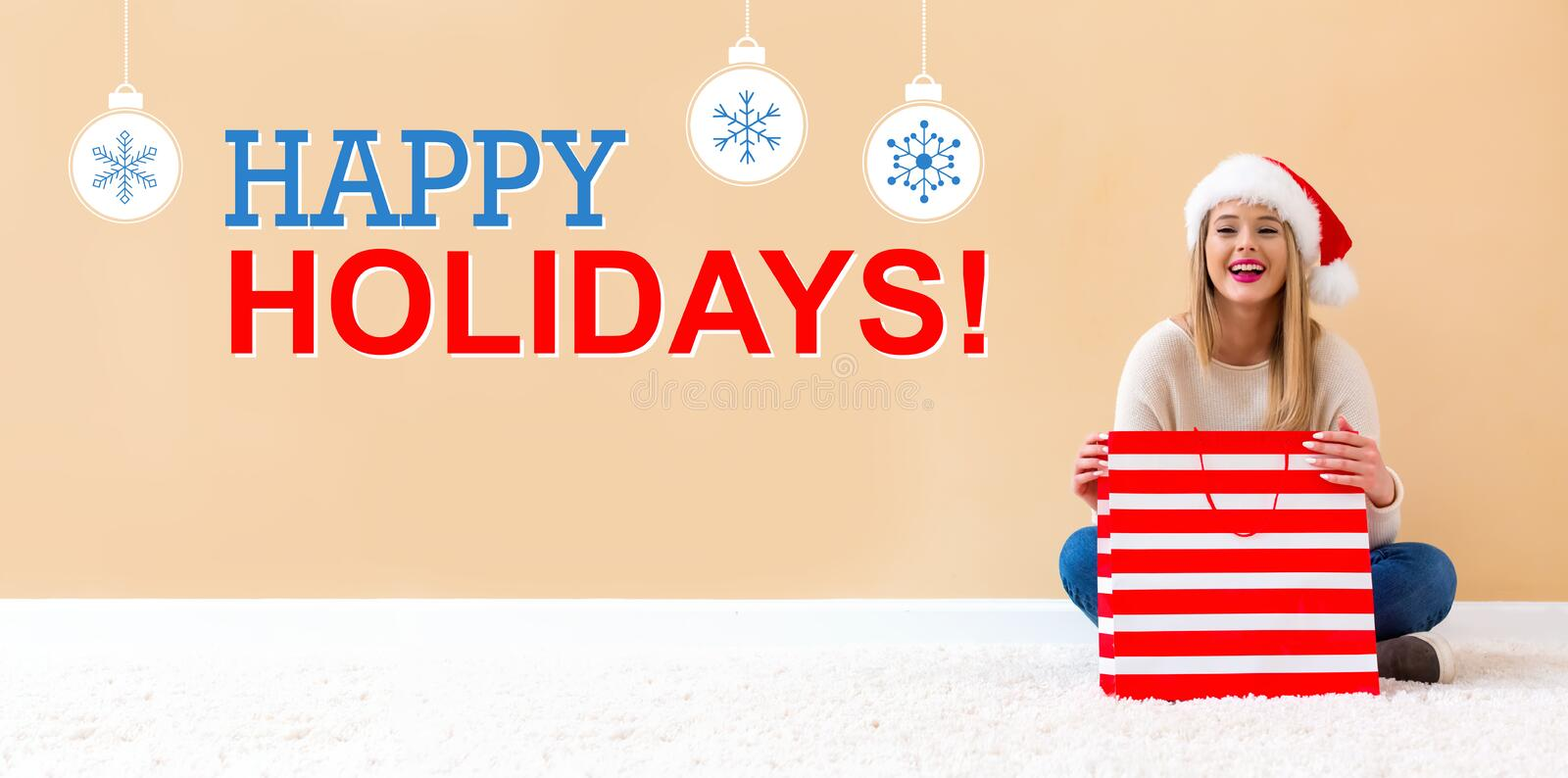 Happy holidays message with woman with Santa hat holding a shopping bag royalty free stock photos