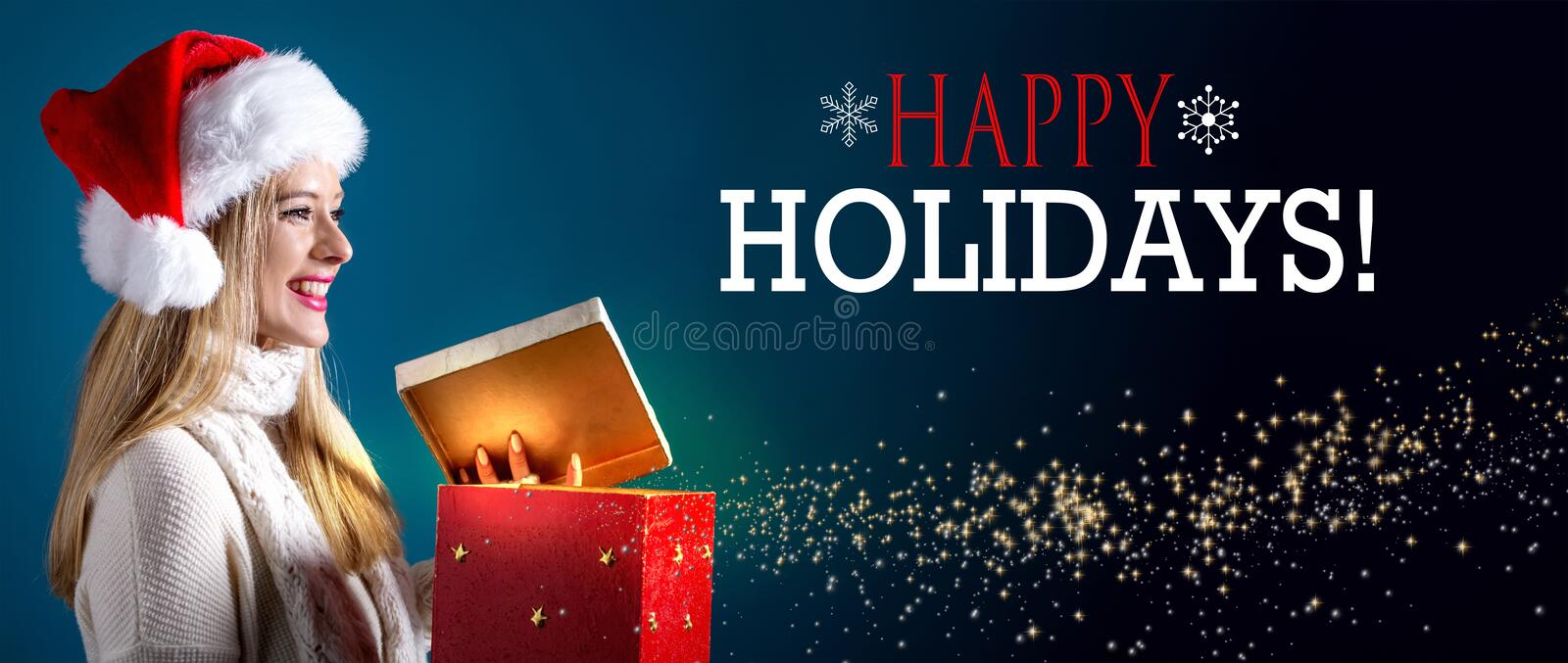 Happy holidays message with woman opening a gift box stock image