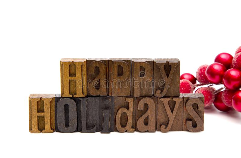 Happy Holidays Spelled in Type Set royalty free stock images