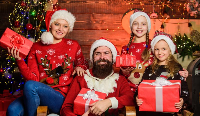 Happy holidays. Spend time with your family. Parents and children opening christmas gifts. Christmas tradition. Boxing. Day. Father bearded men and mother with stock photo