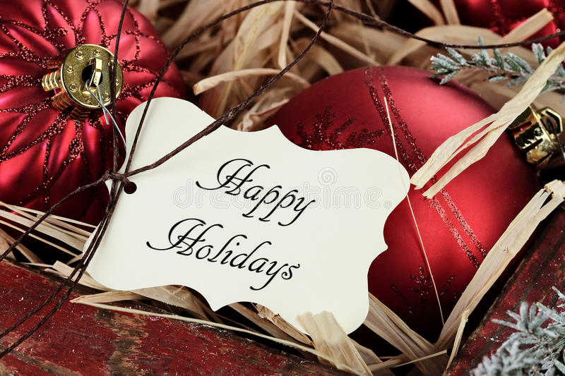 Happy Holidays Tag and Christmas Ornaments royalty free stock images