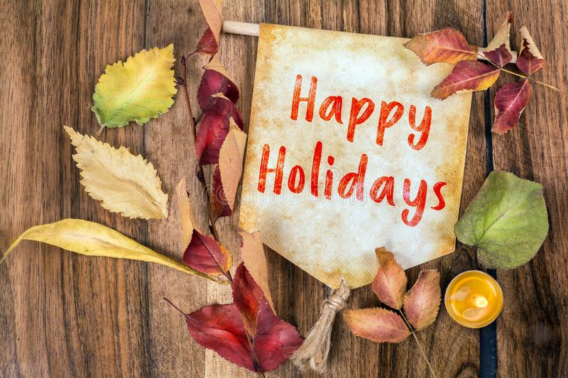 Happy holidays text with autumn theme royalty free stock photos