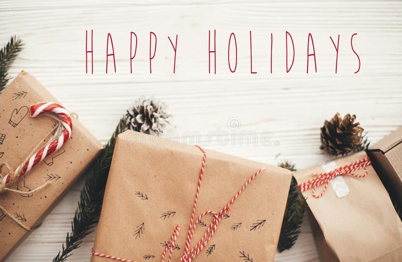 Happy Holidays text on christmas stylish presents with red ribbo stock images