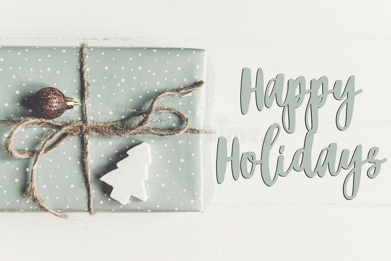 Happy holidays text, seasonal greetings card sign. modern christ stock images