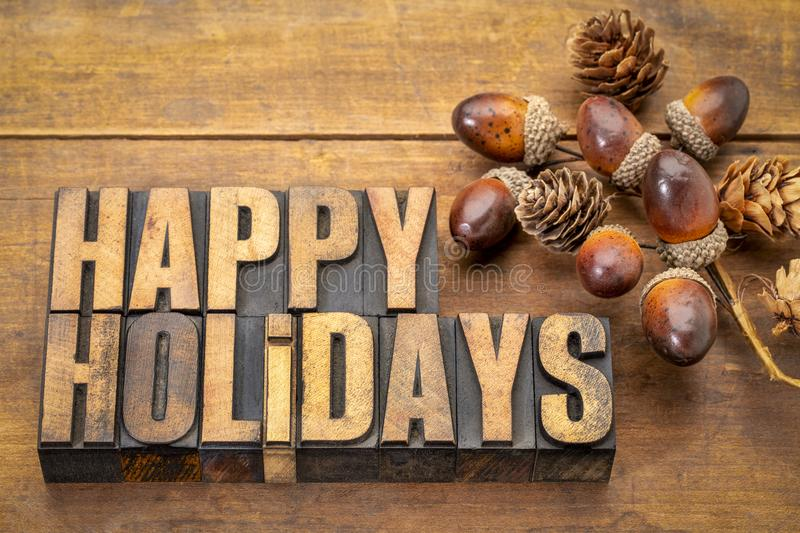 Happy Holidays in wood type royalty free stock photo