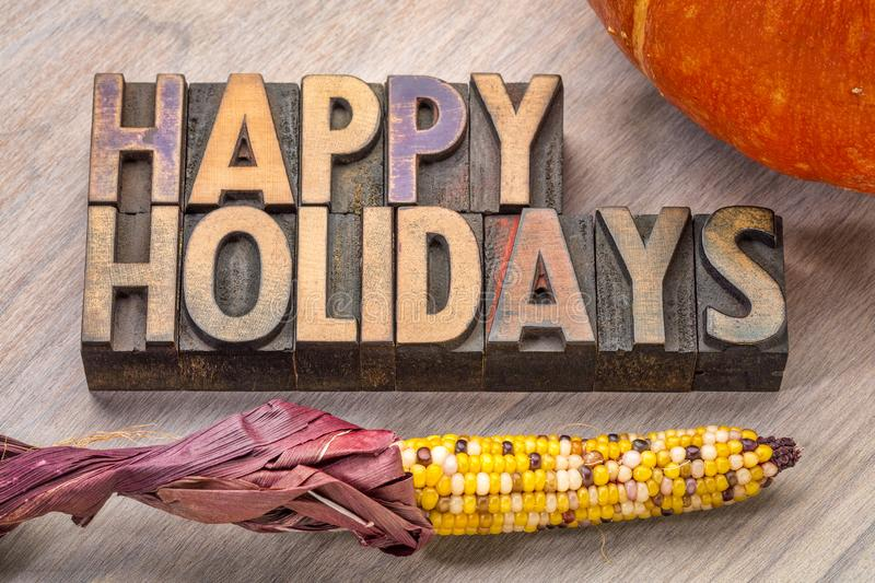 Happy Holidays in wood type stock images