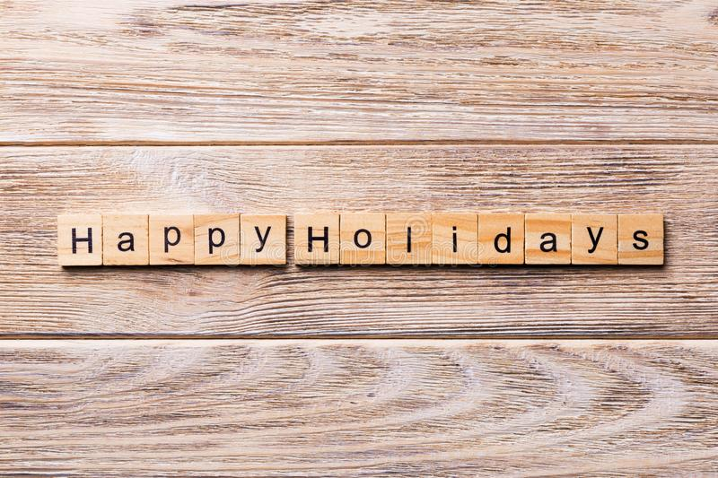 Happy Holidays word written on wood block. Happy Holidays text on wooden table for your desing, concept stock photos
