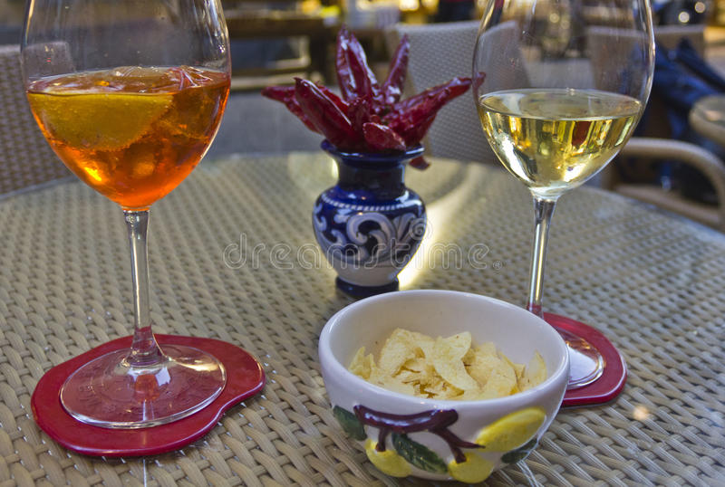 Happy hour in Amalfi. Amalfi, Italy: Happy hour in Amalfi. Two glass, one with a spritz and the other with white wine, with the traditional Amalfi ceramics and royalty free stock photos