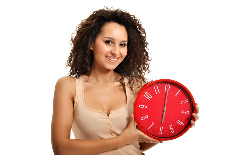 Happy Hour. Beautiful brunette holding clock showing happy hour with a big smile royalty free stock photos