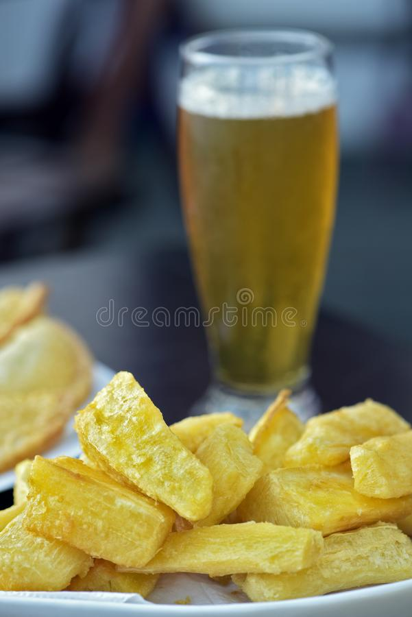 Happy hour: fried cassava and very cold beer royalty free stock images