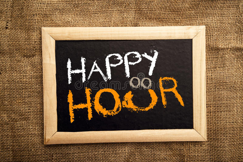 Happy hour. Note on black message board stock photo