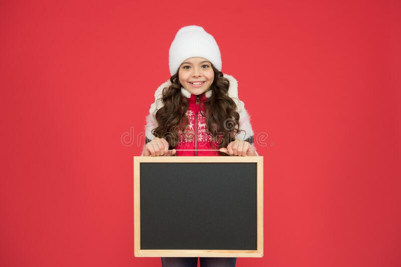 Happy hours. Announcement. Happy girl blank blackboard copy space. Important information. Winter activity advertisement royalty free stock photography