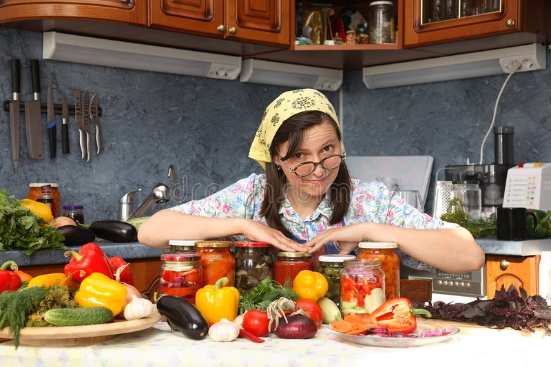 Happy housewife. Brags of canned food of own preparation stock photo