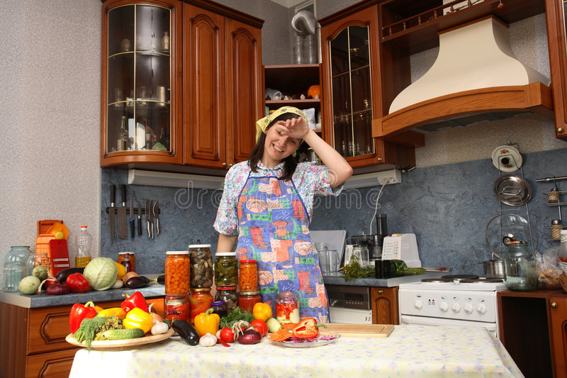 Happy housewife. Brags of canned food of own preparation royalty free stock photo
