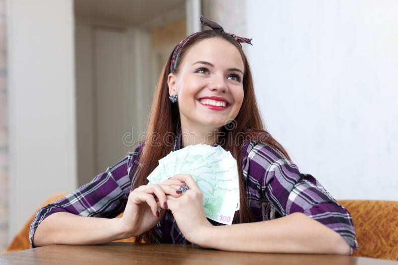Happy housewife with many euro stock photography