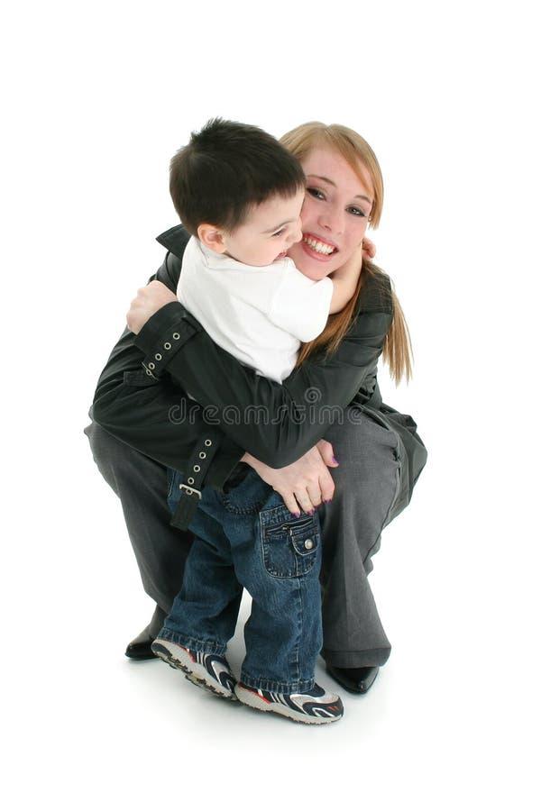 Happy Hug. 14 year old girl and 2 year old boy hugging