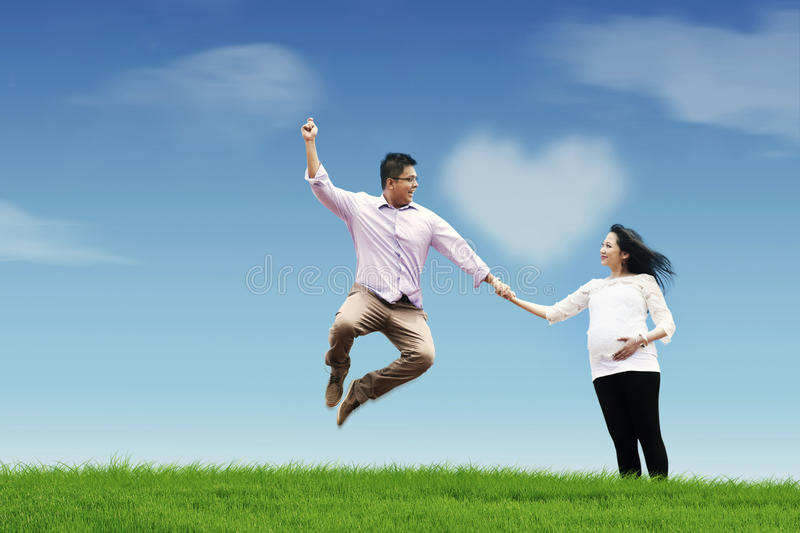 Happy Husband With His Pregnant Wife Royalty Free Stock Photos