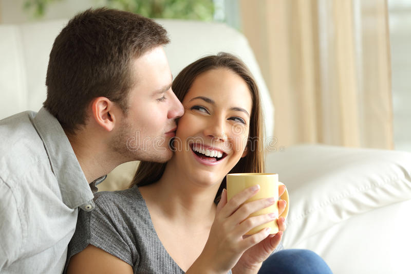 Happy husband kissing his wife. Happy couple royalty free stock photography