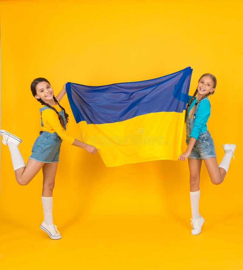 Happy independence day. Children hold ukrainian flag. Ukrainian kids. Celebrate national holiday. Patriotism respect and royalty free stock photography