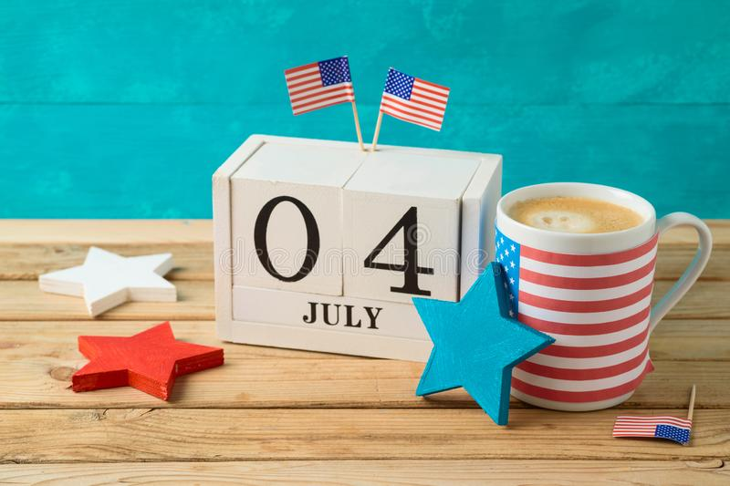 Happy Independence Day, 4th of July celebration concept with coffee cup and american flag on wooden table stock photography
