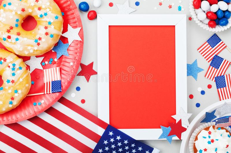 Happy Independence Day 4th july mockup with american flag and sweet foods, decorated with candy, stars and confetti. Top view. stock photography