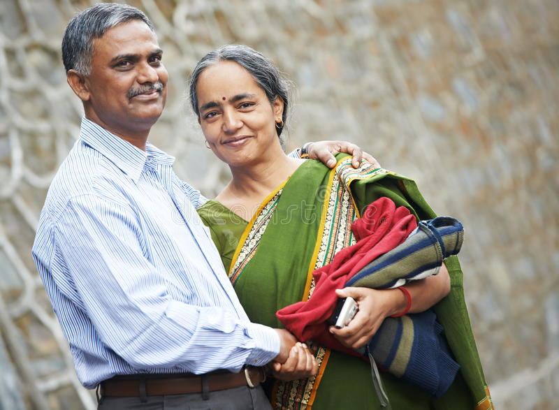 Happy indian adult people couple. Happy Smiling indian adult people couple outdoors royalty free stock images