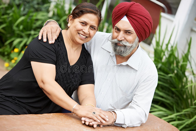 Happy indian adult people couple. Happy Smiling indian sikh adult people couple outdoors royalty free stock image