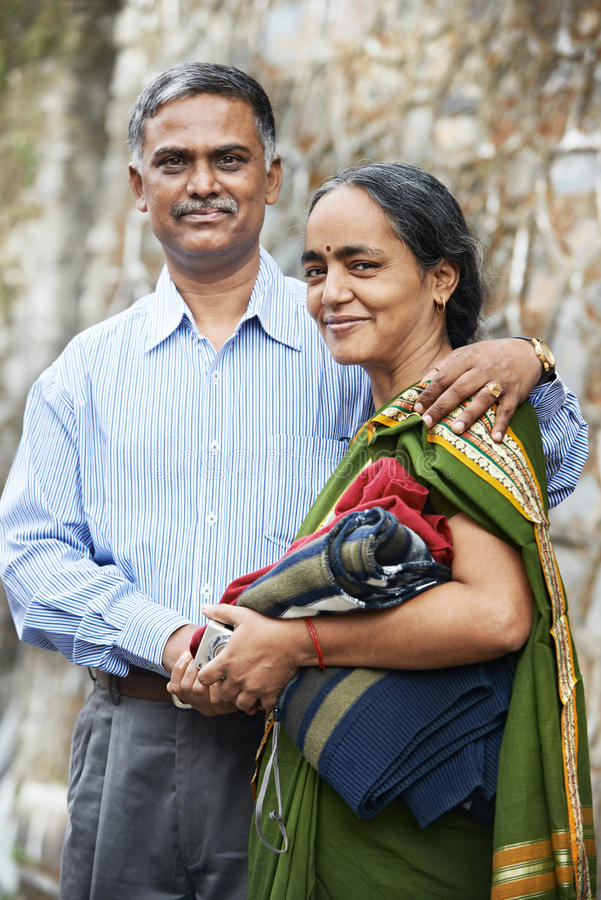 Happy indian adult people couple. Happy Smiling indian adult people couple outdoors royalty free stock photography