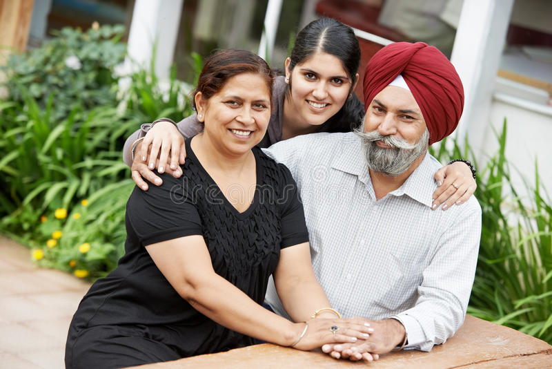 Happy indian adult people family. Happy Smiling indian sikh adult people family outdoors stock photo