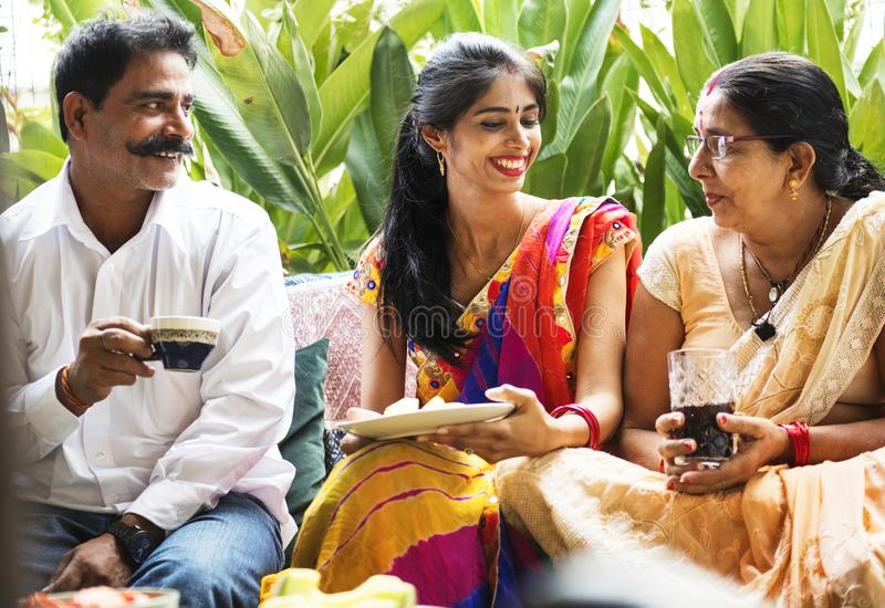 A happy Indian family having beverages together stock photography