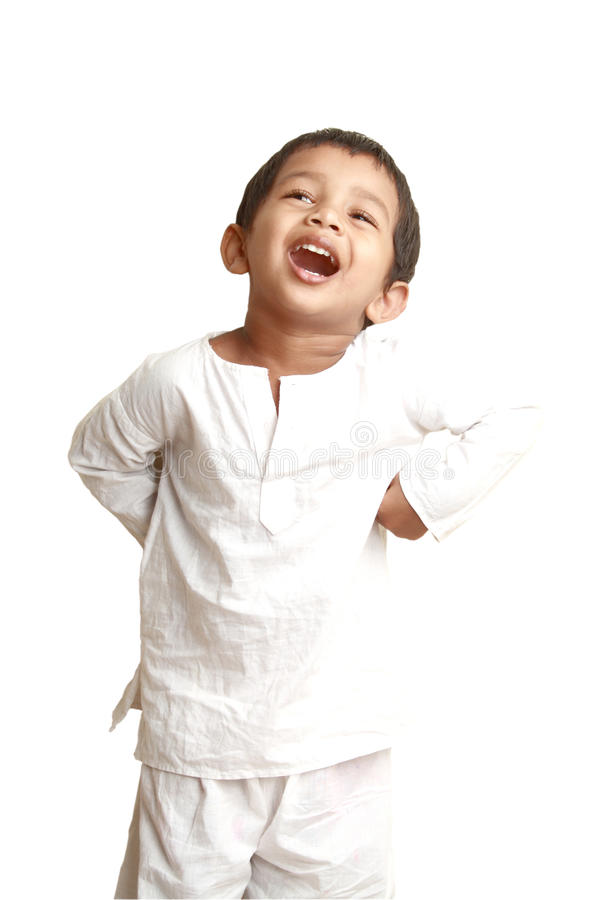 Happy Indian kid. In a traditional dress stock images