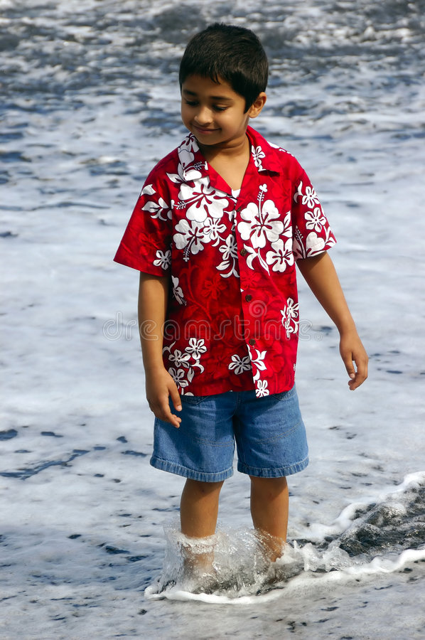 Happy Indian Kid. At a cave in a tropical island royalty free stock image