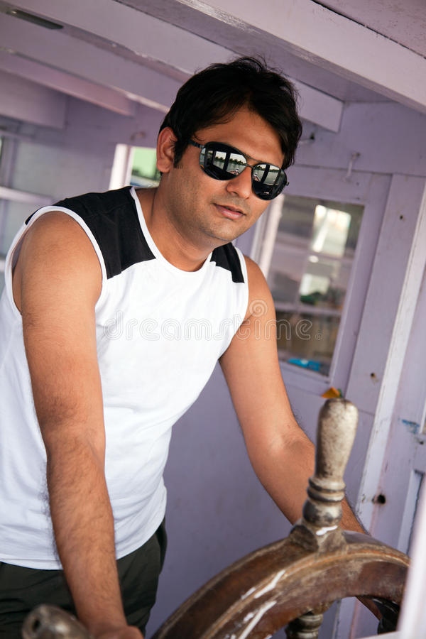 Happy indian man with sunglasses royalty free stock photo