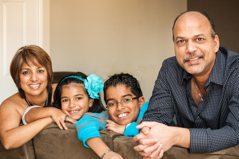 Happy Indian origin family at home stock photography
