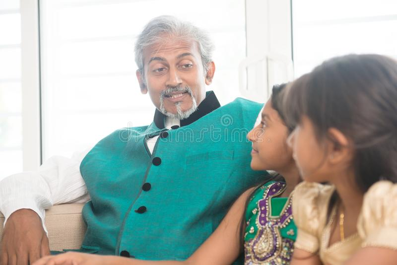 Happy Indian parent and children at home royalty free stock photos