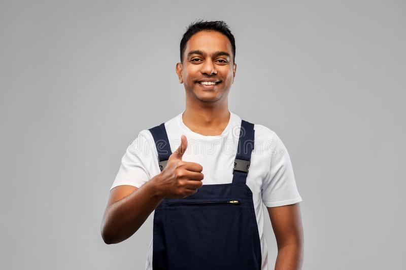 Happy indian worker or builder showing thumbs up royalty free stock photography
