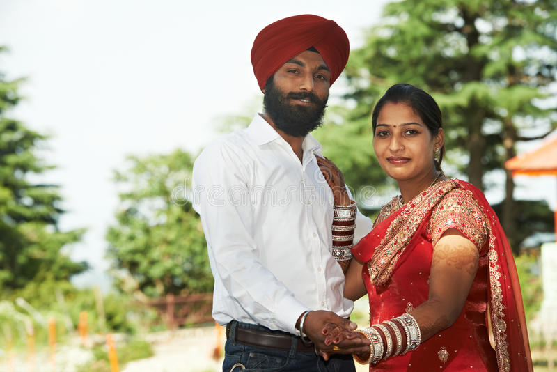 Happy indian young adult married couple stock images