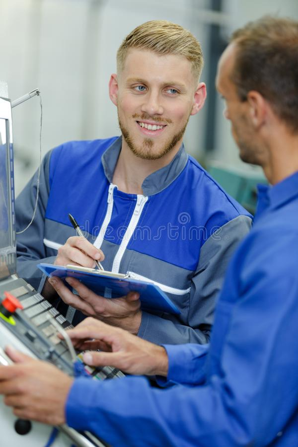 Happy industrial engineers at work stock images