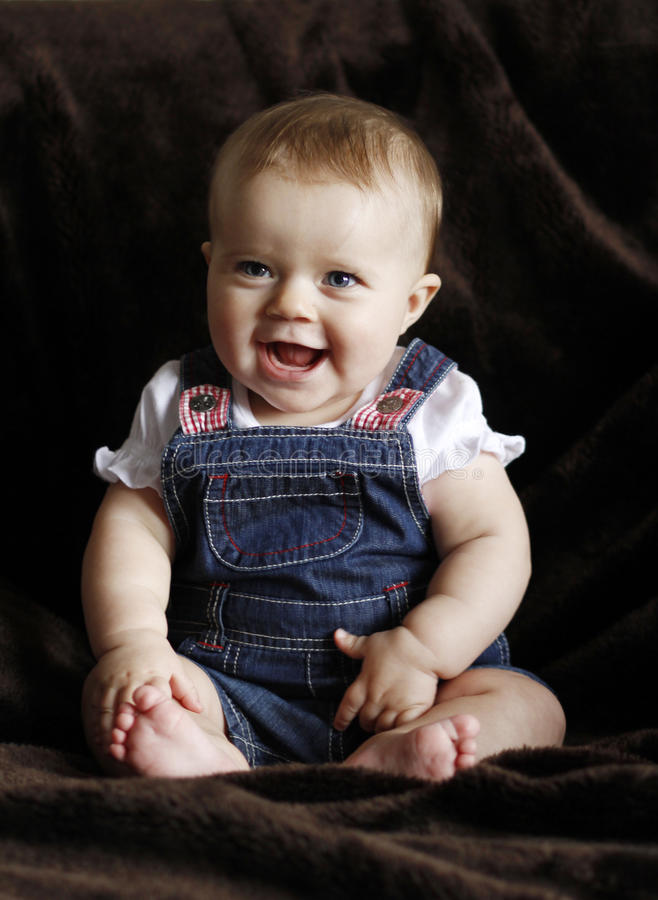 Happy infant baby laughing stock photos