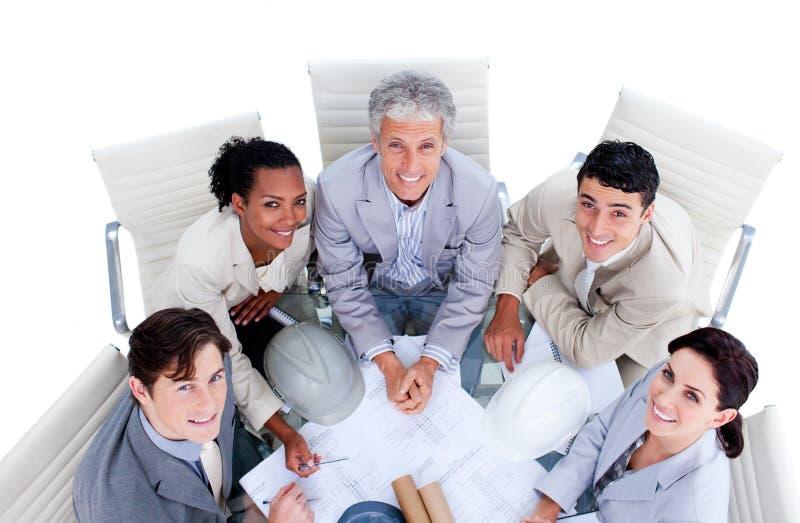 Download Happy International Architects Studying Blueprints Stock Image - Image: 13153763