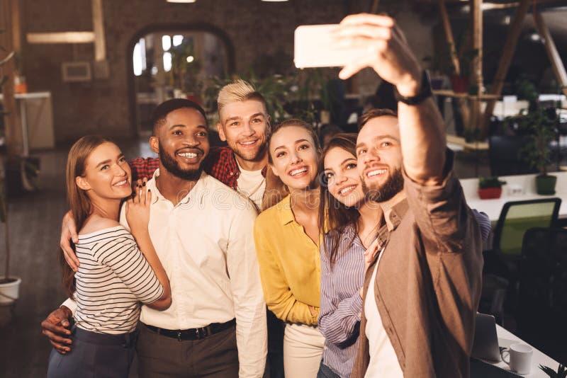 Happy international creative business team taking selfie royalty free stock photos