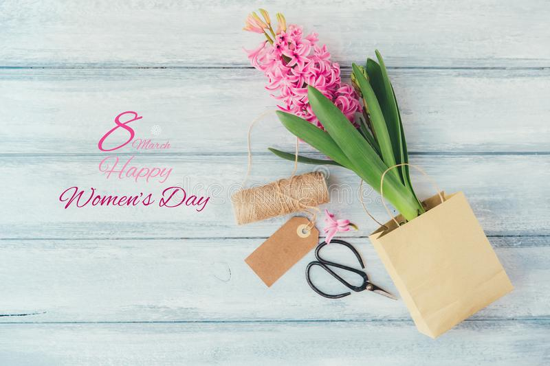 Happy International Women Day, hyacinth over wooden. Background royalty free stock photography
