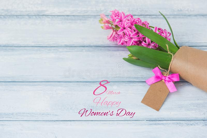Happy International Women Day, hyacinth over wooden background. Top view stock image