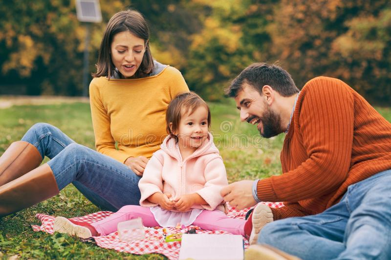 Happy interracial family is enjoying a day in the autumn park. royalty free stock photography