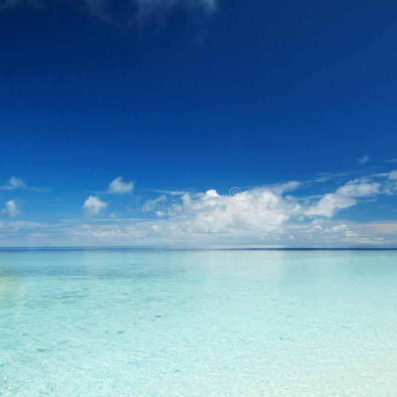 Happy island lifestyle. Ð¡rystal-blue sea of tropical beach. Vacation at Paradise. Ocean beach relax, travel to Maldives stock photo